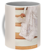 Bride Sitting On Stairs With Lace Fan Coffee Mug