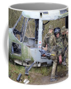 British Soldiers Help A Simulated Coffee Mug