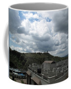 Buildings Cover The Lower Section Of A Hill That Has A Temple At The Top With Clouds Covering The Sk Coffee Mug