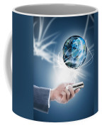 Businessman Holding Mobile Phone With Globe Coffee Mug