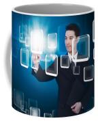 Businessman Pressing Touchscreen Coffee Mug by Setsiri Silapasuwanchai