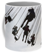 Carnival Goers Enjoy A Ride At An Coffee Mug