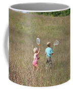 Children Collecting Insects Coffee Mug by Ted Kinsman