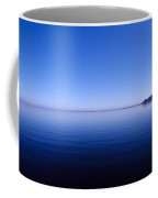Clear Blue Sky Reflected In A Still Coffee Mug