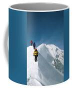 Climbers Hike Along A Ridge Coffee Mug