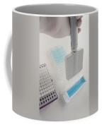 Close Up Of Liquid Aspiration With An Coffee Mug by Greg Dale