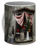Close View Of A Shrine With Oferings Coffee Mug by Sam Abell