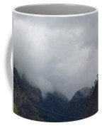 Clouds Covering The Tops Of Various Mountain Peaks Coffee Mug