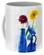 Cobalt Blue Glass Bottles And Gerbera Daisies Coffee Mug