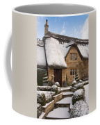 Cotswolds Cottage Covered In Snow Coffee Mug