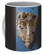 Cracked Face On Blue Wall Coffee Mug