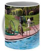 Cycle Near A Swimming Pool And Greenery Coffee Mug