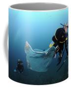 Diver Removes Invasive Indo-pacific Coffee Mug