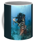 Diver Spears An Invasive Indo-pacific Coffee Mug