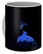 Diver With Lights Entering A Submerged Coffee Mug
