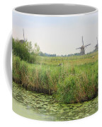 Dutch Landscape With Windmills And Cows Coffee Mug by Carol Groenen