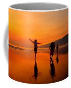 Family Running In The Beach At Sunset Coffee Mug