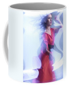 Fashion Photo Of A Woman In Shining Blue Settings Wearing A Red  Coffee Mug
