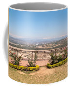 Fence And Garden Overlooking A Beautiful Vista Of Valley And Snow-capped Mountains Coffee Mug