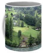 Few Houses On The Slope Of Mountain Next To Lake Lucerne Coffee Mug