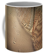 Footprints On The Beach Along A Fence Coffee Mug