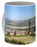 Garden With Some Beautiful Roses Overlooking A Valley With Snow Capped Mountains In The Background Coffee Mug