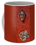 Gaslight On A Red Wall Coffee Mug