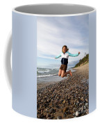 Girl Jumping At Lake Superior Shore Coffee Mug