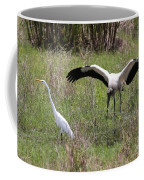Great Egret And Wood Stork In The Marsh Coffee Mug