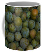 Green Plums Fill A Bin Outside A Local Coffee Mug by Heather Perry