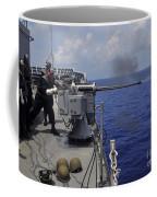 Gunner Fires A Mark 38 Machine Gun Coffee Mug