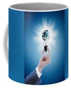 Hand Holding Light Bulb With Globe  Coffee Mug
