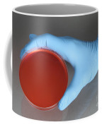 Hand Holding Petri Dish Coffee Mug