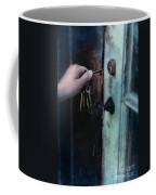 Hand Putting Vintage Key Into Lock Coffee Mug