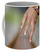 Hand Touching A Railroad Track Coffee Mug