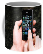 Hands Holding An Iphone Coffee Mug by Photo Researchers, Inc.