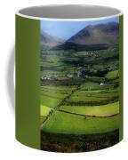 High Angle View Of Buildings In A Coffee Mug