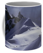 Hikers Follow Paths Across The Snow Coffee Mug
