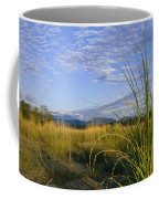 Hills Loom In The Distance Coffee Mug