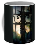 Hooded Figure By A Fire Coffee Mug