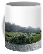 Houses On The Greenery Of The Slope Of A Mountain Next To Lake Lucerne Coffee Mug by Ashish Agarwal