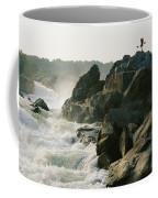 Kayaker Carries Boat Up The Rocks Coffee Mug