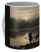 Kayakers Paddle Through Still Water Coffee Mug