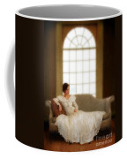 Lady Sitting On Sofa By Window Coffee Mug
