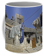 Laundry Hangs In The Courtyard Coffee Mug by Stocktrek Images