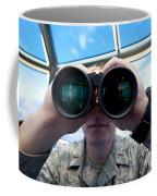 Lieutenant Uses Binoculars To Scan Coffee Mug by Stocktrek Images