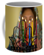 Lighting The Chanukia Coffee Mug