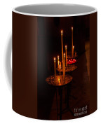 Lit Candles In A Church Coffee Mug
