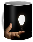 Lit Light Bulb Balancing On Finger Coffee Mug