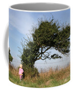 Little Girl And Wind-blown Tree Coffee Mug